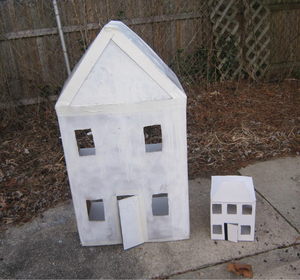 How to make a cardboard house with recycled materials