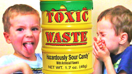 Toxic Waste Challenge Extreme Sour Candy Kids Edition - Eli and Liam