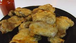Betty's Baked Boneless, Skinless Chicken Thighs with Light-Tasting Buffalo Sauce -- Super Bowl