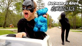 Batman Vs SCARY ALIEN SHADOW ATTACKS World's Largest Gummy Bear Bad Baby In Real Life
