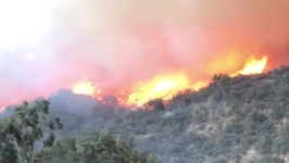Strong Winds Push Flames Through Montecito Hills