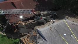 Airborne Car Crashes Onto Roof of St Louis Home