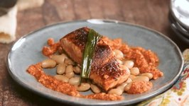 Pan Seared Catalan Romesco Verlasso Salmon - Thyme Cannellini Beans And Charred Green Onions
