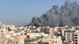 Plumes of Smoke Spread Across Manama Amid Large Fire at Salman Port