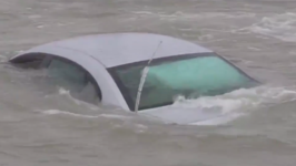 Car Abandoned on Slippery Wisconsin Road is Claimed by Lake Michigan