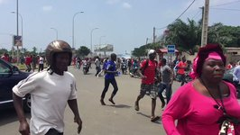 Anti-Government Protesters Flee Tear Gas in Lome