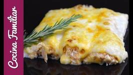 Canelones de atún gratinados con queso. Con la receta de la bechamel