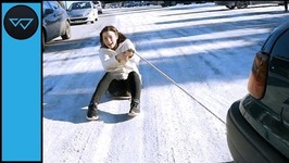 Friends Beat the Winter Blues by Sliding Behind a Car