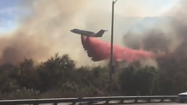 Fire Crews Work to Douse Wind-Fueled Lilac Fire