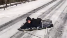 Homemade Sled Gets Towed Through Alabama Snow