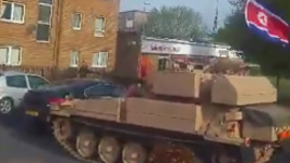 Lads Dressed as Kim Jong-Un and Donald Trump Ride Tank Through Peterlee