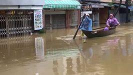Tourists Navigate Flooded Hoi An via Kayak