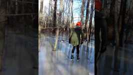 Woman Majestically Ice Skates Through Frozen Forest