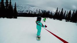 Kids Show Parents How It's Done on Snowboarding Adventure