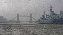 London's Marine Police Capture Snow Falling on Thames