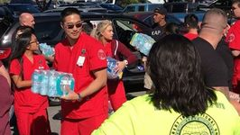 Las Vegas Blood Bank Workers Offload Bottled Water Donations