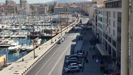 Police on the Scene After Vehicle Hits Bus Stops in Marseille