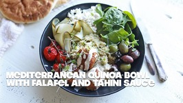 Mediterranean Quinoa Bowl With Falafel And Garlic Tahini Sauce