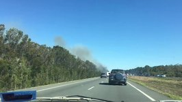 Bushfire's Heavy Smoke Reduces Visibility Along Bruce Highway