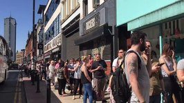 Hundreds Line Up to be Inked With Manchester Bee