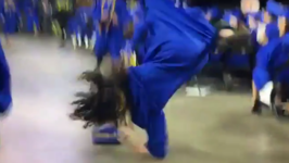 Man Tries to Somersault at Graduation, Fails Miserably