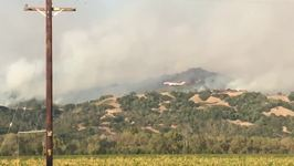 Evacuated Family Watches Giant 747 Drop Retardant Over California Wildfires