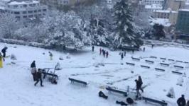 Parisians Take the Piste in Montmartre as Snow Blankets Ile-de-France
