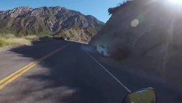 Extremely Close Call For Motorcyclist As On-Coming Car Spins Out of Control