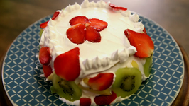Eggless Mixed Fruit Cake With Cream Icing - Recipe By Archana - Easy To Make At Home