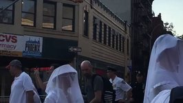 People Wearing White Outfits and Veils Make Their Way to Stonewall Inn For Pulse Vigil
