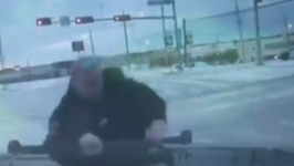 Texas Police Officer Slips, Slides on Ice While Directing Traffic
