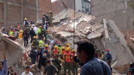 Emergency Workers Respond to Collapsed Building After Mexico Earthquake