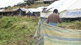 Rohingya Refugees Crowd Makeshift Shelters on Muddy Embankment