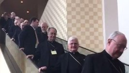 Here's Nine Minutes of Bishops Coming Down an Escalator