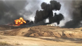 Iraqi Engineers Tackle Oil Field Fires Set by Islamic State