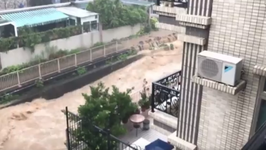 Torrent of Floodwater Courses Through Hong Kong's Northeastern Tai Po District
