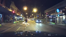 Skater and Board Part Ways While Crossing Road