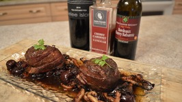 Pan Seared Bacon Wrapped Wild Boar Medallions Oyster Mushroom And Bordeaux Cherry Balsamic Sauce