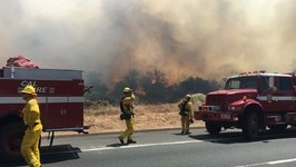 Helicopters Drop Water on Rapidly Growing Brush Fire Near San Diego