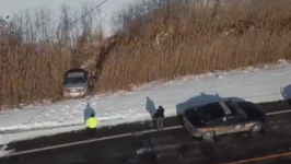 Driver Escapes Injury After Car Veers Onto Frozen Pond