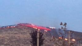 Firefighting Plane Drops Retardant on Earthstone Fire Near Reno