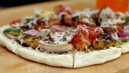 How To Make A Grilled Vegetable And Sausage Pizza