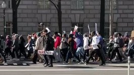 Thousands of Students March Past Trump International Hotel in Washington DC
