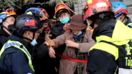 Woman Rescued from Rubble Following Deadly Taiwan Earthquake