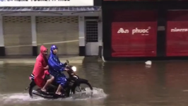 Motorbikes Speed Through Hue's Flooded Streets