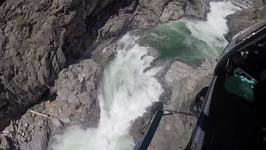 California Highway Patrol Chopper Rescues Swimmer Stuck on Rock in Raging River