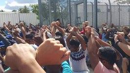 Asylum Seekers on Manus Island Cross Hands in Silent Protests