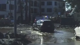 Montecito Residents Drive Through Flooded Neighborhood Following Storm