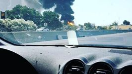 Large Warehouse Fire Seen From Highway in French Camp