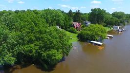 Fox River Flooding Nears Record Highs As Floodwaters Pour into Backyard